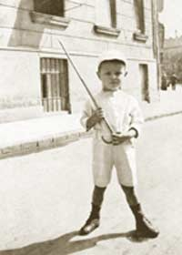 Four year old Ferenc in front of his home